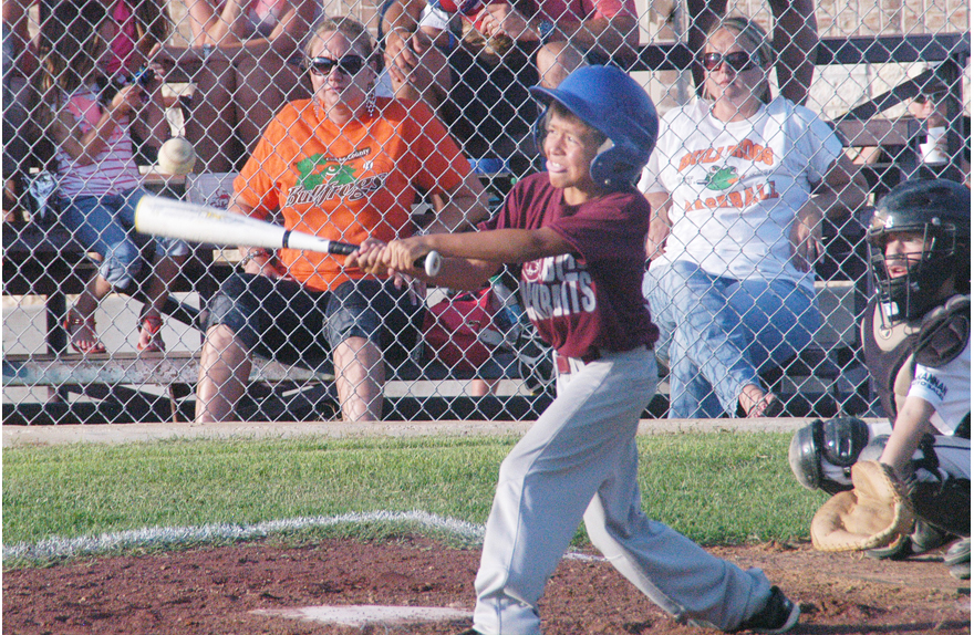 Andrew Chancellor of the Bowie Jackrabbits gets the bat on the ball during a pool play game against the Clay County Bullfrogs on Friday night at Haggar Sports Complex. (Photo by Eric Viccaro)