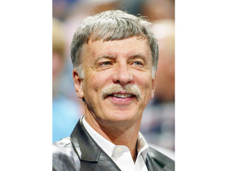 ** FILE ** Stan Kroenke, owner of the Denver Nuggets, smiles as the Nuggets beat the San Antonio Spurs 102-84 in this April 1, 2005 file photo, in Denver.  Kroenke said Thursday, April 5, 2007, that he has bought a nearly 10 percent stake in London's Arsenal soccer team. Kroenke also owns the the Colorado Avalanche  hockey team and the Colorado Rapids of Major League Soccer.  (AP Photo/Jack Dempsey)