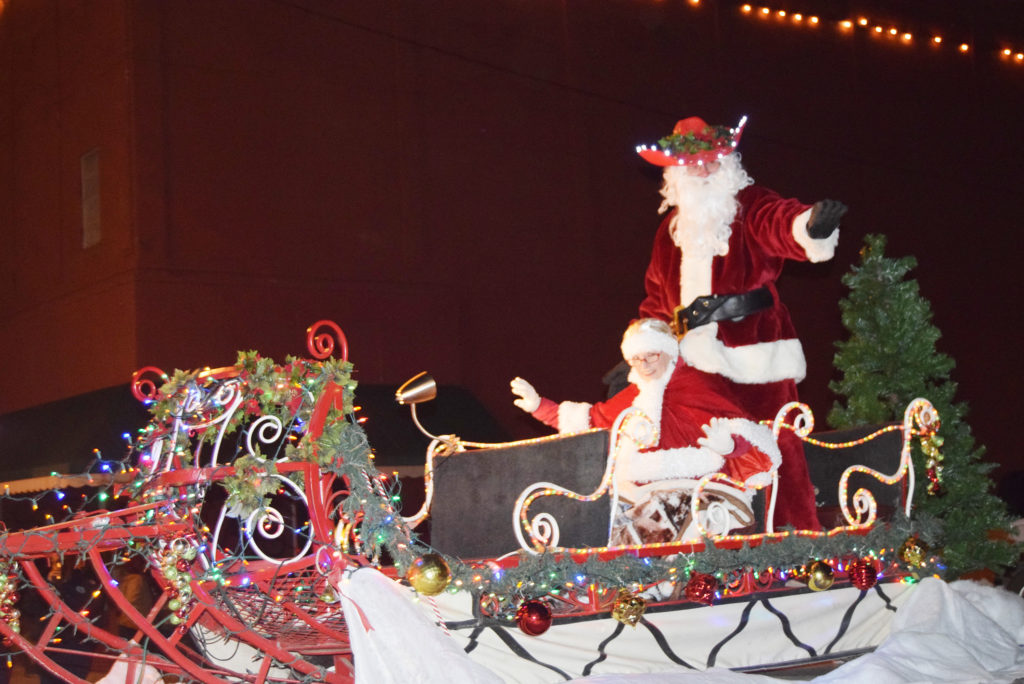 Santa and Mrs. Claus arrive for the 25th annual Fantasy of Lights Christmas Parade Thursday. (Photo by Barbara Green)