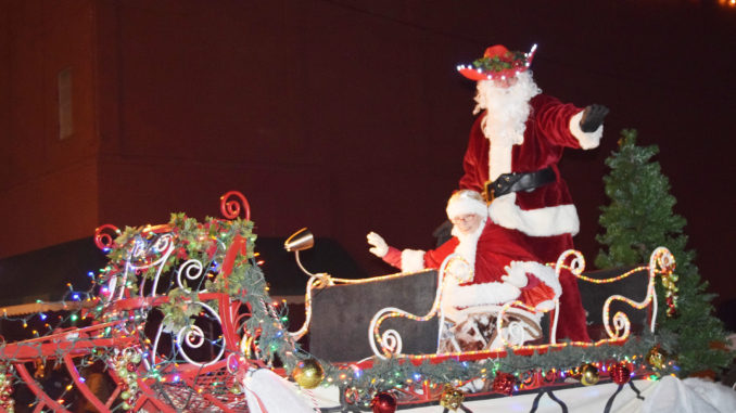 santa and mrs claus arrive for the annual fantasy of light christmas parade news file photo